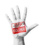 Open hand raised, Stop Violence sign painted, multi purpose conc